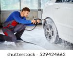 man worker washing luxury car... | Shutterstock . vector #529424662