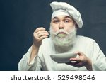 bearded man cook in hat tasting ... | Shutterstock . vector #529498546