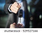 Male Adult Dealer Hand Giving...