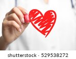 cardiologist drawing heart ... | Shutterstock . vector #529538272