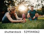 fitness couple stretching... | Shutterstock . vector #529544062