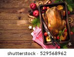 roast duck with apples and... | Shutterstock . vector #529568962