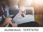 young hipster girl playing... | Shutterstock . vector #529576702