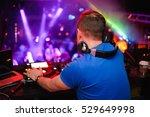 dj stands before the mixer   Shutterstock . vector #529649998
