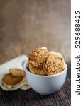 cookies in cup on a wooden table | Shutterstock . vector #529688425