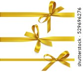 Vector set of decorative golden bows with horizontal ribbon isolated on white. Yellow bow for gift decor | Shutterstock vector #529696276