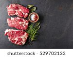 pork meat with spices on a... | Shutterstock . vector #529702132