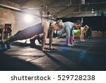 group of adults doing push up... | Shutterstock . vector #529728238