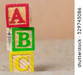 Small photo of wooden ABC blocks on sack background.