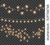 vector shining christmas lights.... | Shutterstock .eps vector #529768768
