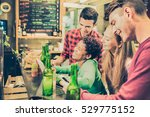 multiracial friends drinking... | Shutterstock . vector #529775152