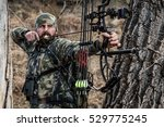 Bow Hunter Drawn Back Shooting