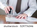notary public in office...   Shutterstock . vector #529776346