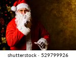 santa claus with finger on lips ... | Shutterstock . vector #529799926