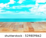 wood table on sea and sky... | Shutterstock . vector #529809862