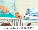closeup of woman ironing... | Shutterstock . vector #529873498