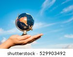 hand holding globe against a... | Shutterstock . vector #529903492
