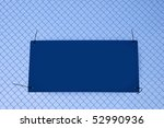 sign left blank for copy tied to a wire fence - stock photo