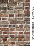 Close up of a very old brick wall. - stock photo