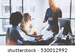 young team of coworkers making... | Shutterstock . vector #530012992