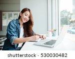 indoor picture of smiling asia... | Shutterstock . vector #530030482