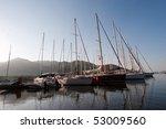 Sailing boats in turkish marine at sunrise - stock photo