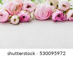 Stock photo beautiful spring ranunculus flowers on gray stone table floral border pastel color greeting card 530095972