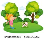 girl playing with pet dog in...