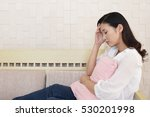 woman who has a headache | Shutterstock . vector #530201998