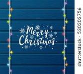 christmas light bulbs on wooden ... | Shutterstock .eps vector #530203756