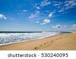 Ocean Beach With Footprints On...
