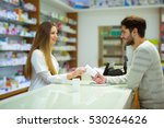 attractive smiling pharmacist... | Shutterstock . vector #530264626