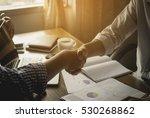 business handshake of two men. | Shutterstock . vector #530268862