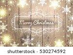 christmas frame on wooden... | Shutterstock .eps vector #530274592