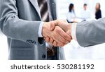business man shaking hand to... | Shutterstock . vector #530281192