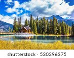 bridge over emerald lake.... | Shutterstock . vector #530296375