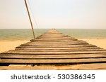 old wooden bridge towards to... | Shutterstock . vector #530386345
