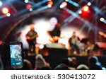 spectator holding smart phone... | Shutterstock . vector #530413072