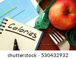 Small photo of Calories written in a diary. Calorie counting concept.