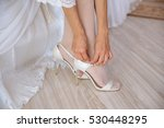 the bride wears white shoes on... | Shutterstock . vector #530448295