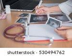Doctor Holding Ultrasound...