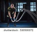 men with battle rope battle... | Shutterstock . vector #530500372