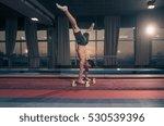 young man  two hand cartwheel.... | Shutterstock . vector #530539396