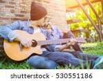 hipster man playing guitar for... | Shutterstock . vector #530551186