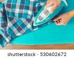 closeup of woman ironing... | Shutterstock . vector #530602672