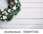 christmas wreath on wooden...   Shutterstock . vector #530697352