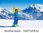 child skiing in mountains.... | Shutterstock . vector #530710522
