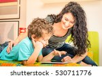 young mother having fun with... | Shutterstock . vector #530711776