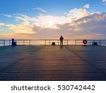 alone man on pier and look over ... | Shutterstock . vector #530742442