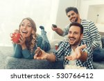 group of friends watching tv... | Shutterstock . vector #530766412